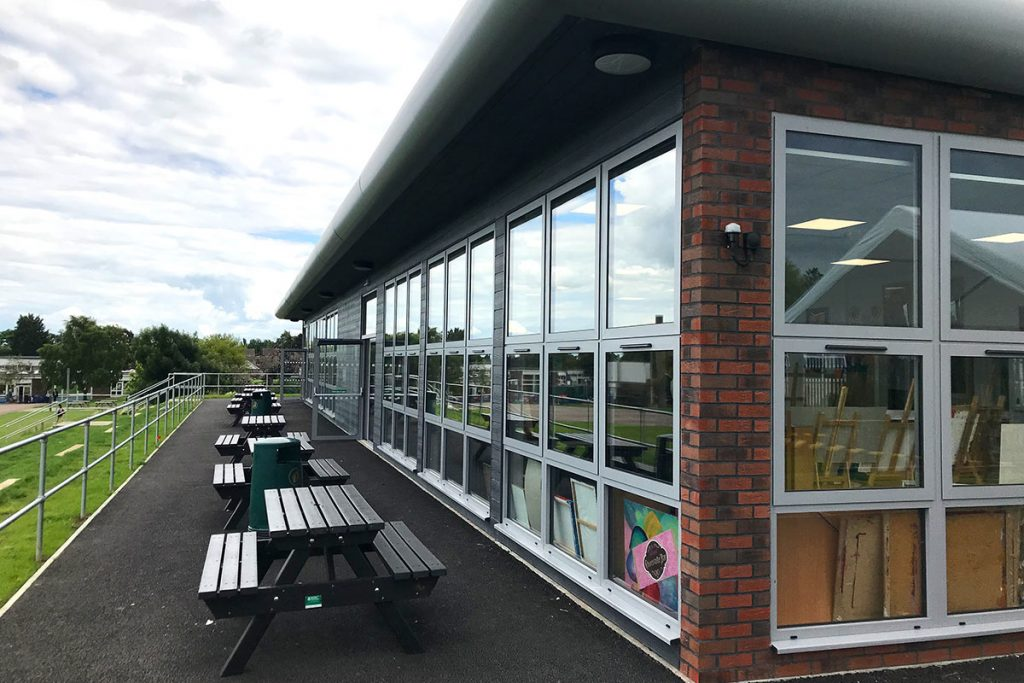 Seating and large windows of the modular classroom