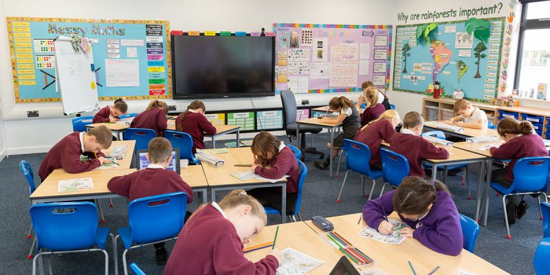 Children busy working in the classroom at St Stephens