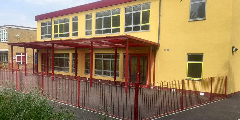 Riverside Primary School front with yard and canopy