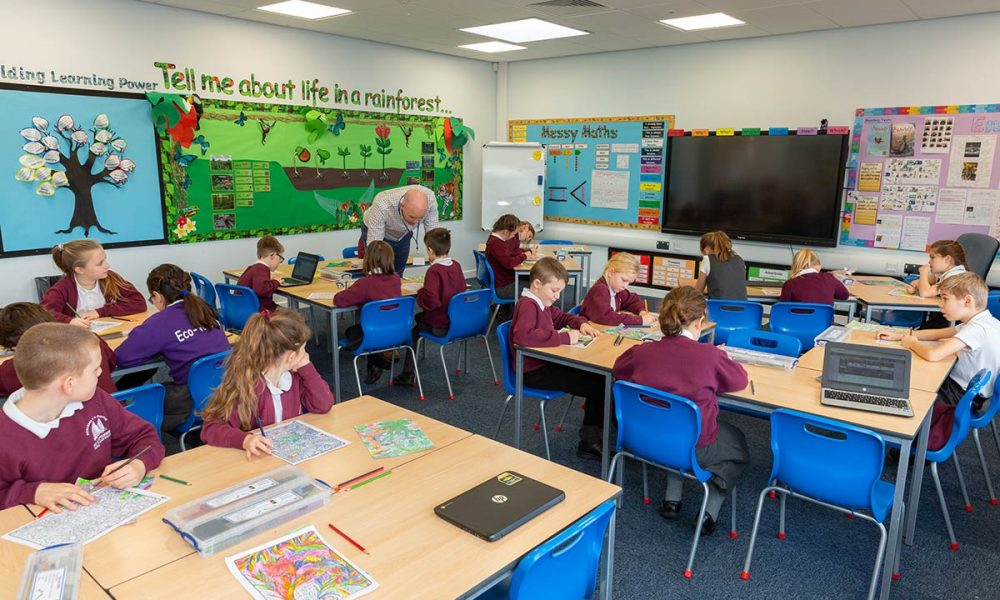 Modular classroom at St Stephens full of young school children