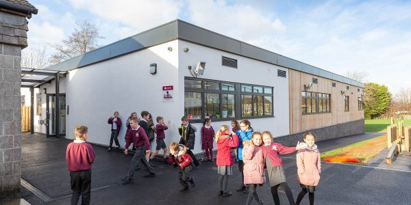 Children playing outside the new modular building at St Stephens Primary School