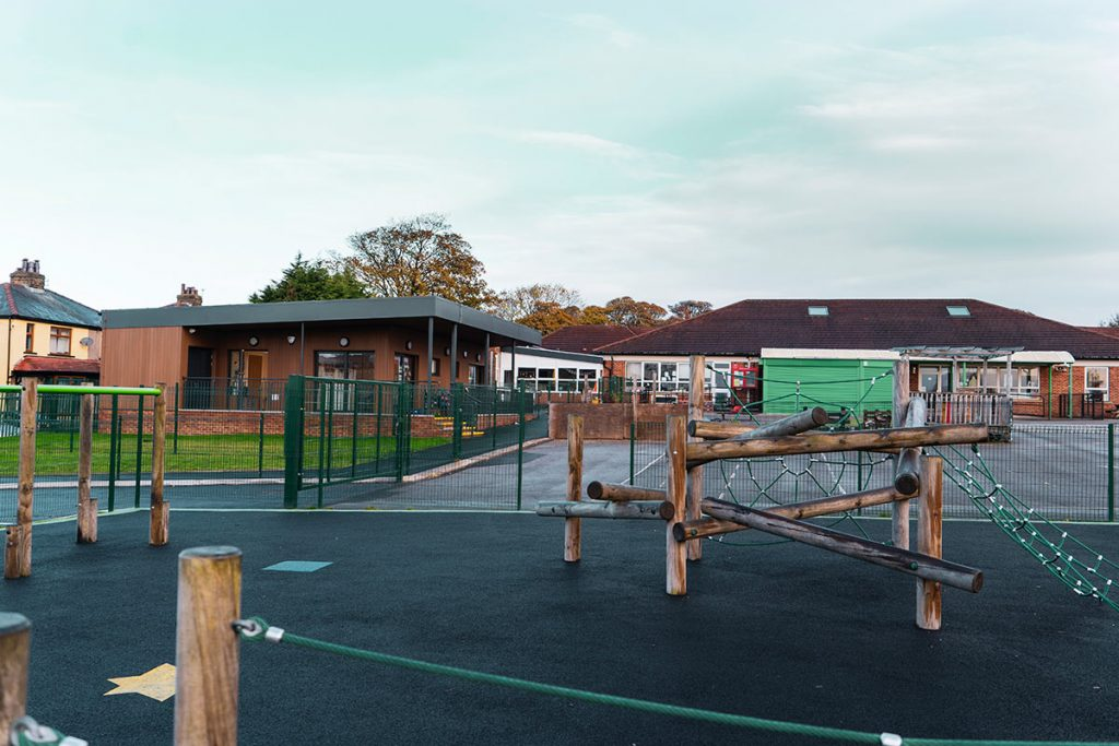 View across the playground at Low Ash to the new energy efficient building